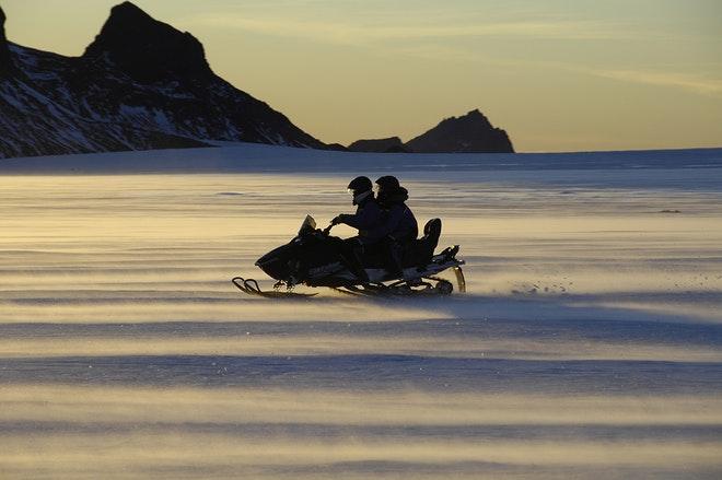 Midnight Sun & Snowmobiling from Húsafell